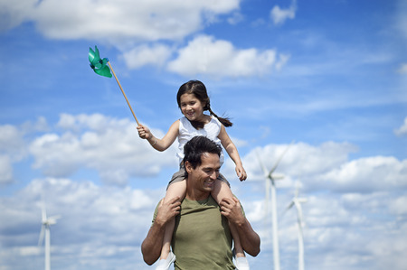 Father and daughter on a wind farm LANG_EVOIMAGES