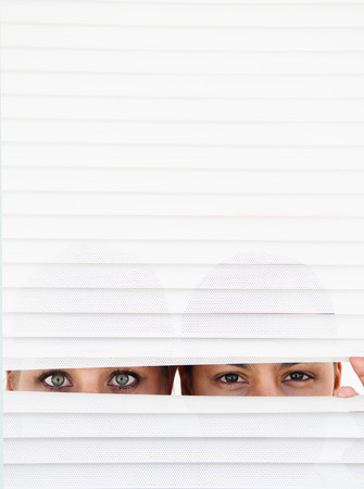 detects: Two women look through blinds