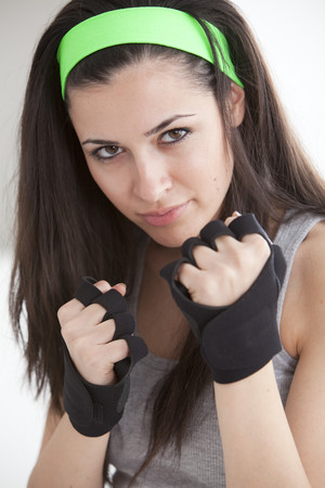 aggressively: Defensive woman in boxing gloves