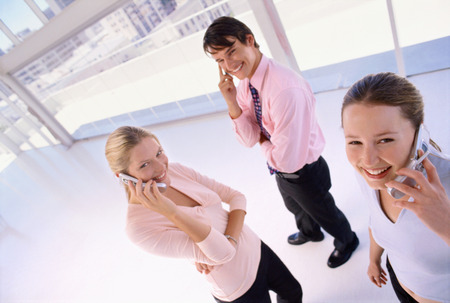acknowledging: Business people talking on cell phones