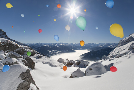 context: Ballons flying over winter landscape