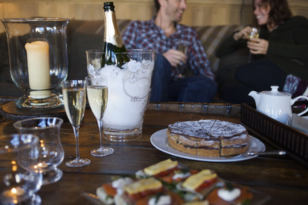 lavish: Couple having cake and champagne