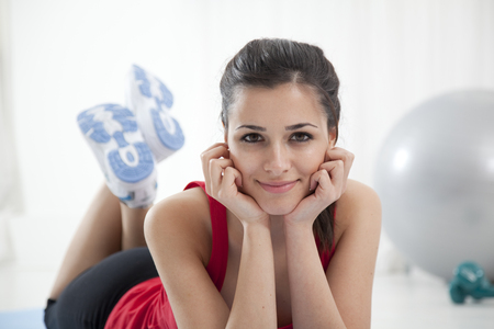 Woman laying in exercise clothes