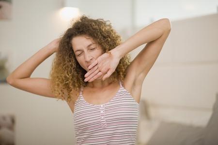 awakened: Woman yawning and stretching