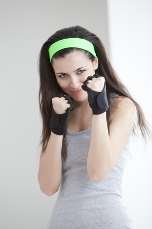 Defensive woman wearing boxing gloves