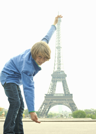 whimsy: Boy posing with Eiffel Tower in Paris
