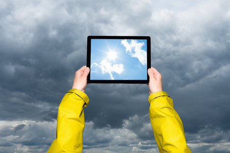 low perspective: Child viewing storm on tablet computer  LANG_EVOIMAGES