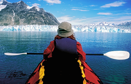 paddles: Man kayaking in glacial lake