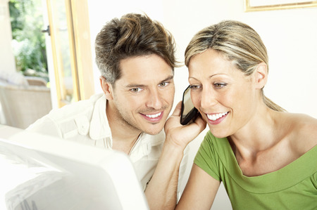 eavesdropper: Couple talking on cell phone together