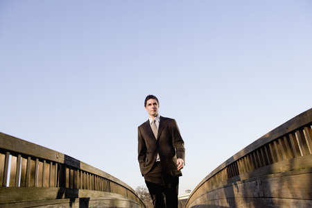 intersects: Businessman standing on wooden walkway