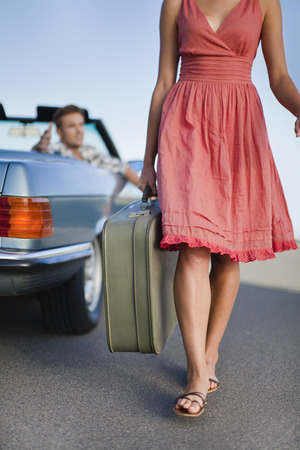 sever: Woman leaving man in convertible LANG_EVOIMAGES