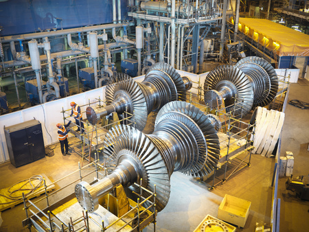 scaffolds: Workers with turbines in power station