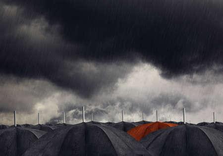drizzling rain: Red umbrella with black umbrellas