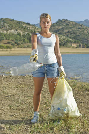 carryall: Girl cleaning up rural field