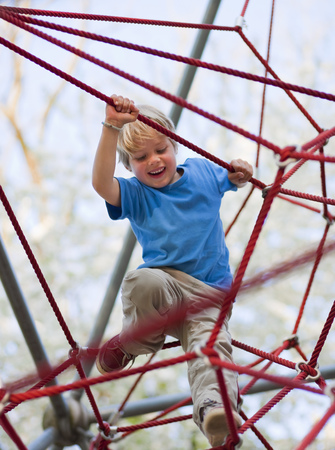 climbed: Boy climbing at playground LANG_EVOIMAGES