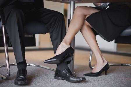 consulted: Businesswoman flirting with colleague