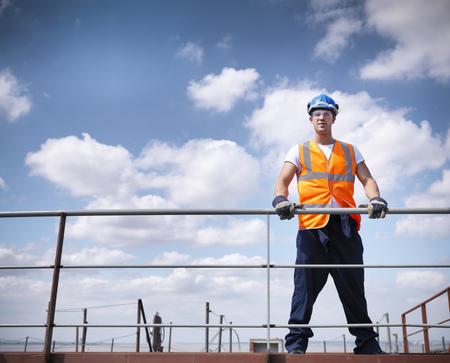 Worker standing on ship LANG_EVOIMAGES