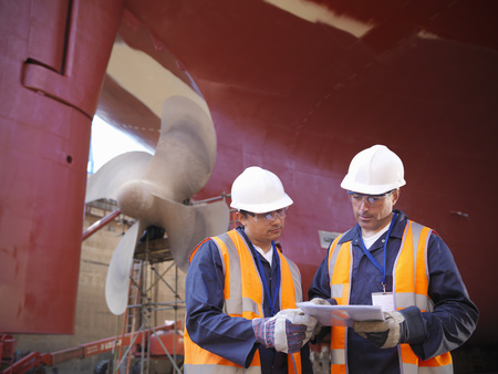 shipped: Workers talking on shipbuilding site LANG_EVOIMAGES