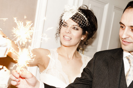 lighted: Newlywed couple with sparklers on cake
