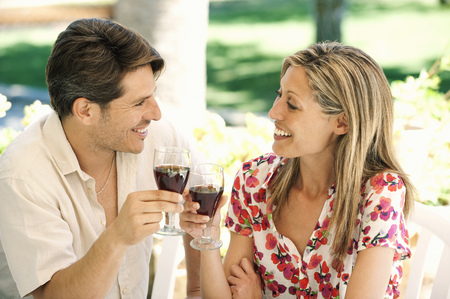 regard: Couple toasting each other outdoors