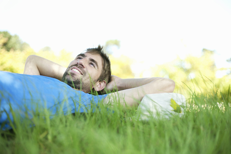 Man laying in tall grass