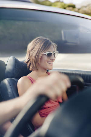 appendages: Woman riding in convertible