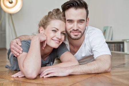 Couple embracing on floor