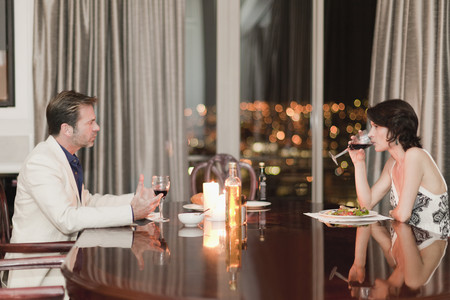 abodes: Couple having romantic dinner at home