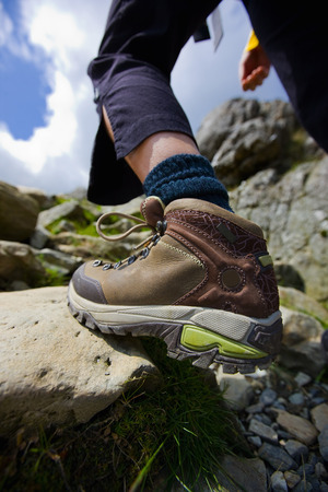 Close up of hiker's boot on rock