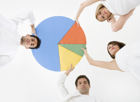 People holding pie chart