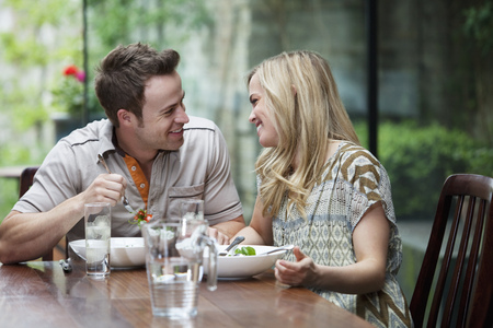 Couple talking over meal at home