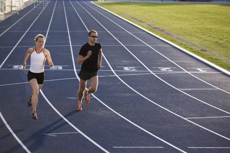 rehearse: Runners racing on track