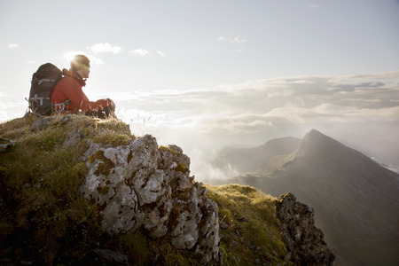 climbed: Hiker overlooking view from mountaintop