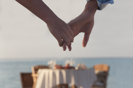 seascapes: Couple holding hands