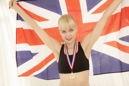 Athlete with medal and Union Jack flag