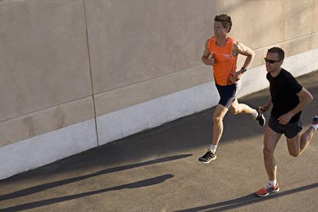 athleticism: Runners jogging together LANG_EVOIMAGES