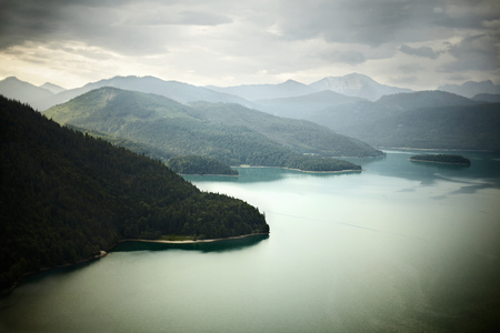 mountainous: Aerial view of mountains and still lake LANG_EVOIMAGES