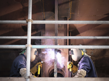 2 50: Welders at work building ship
