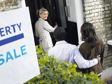 Realtor showing couple property for sale LANG_EVOIMAGES