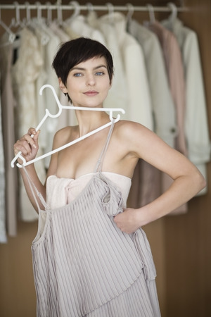 indecisive: Woman picking clothes from closet