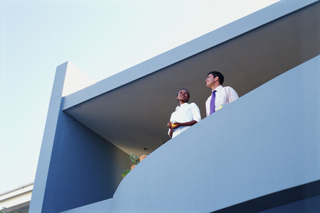 beau: Couple overlooking view from balcony