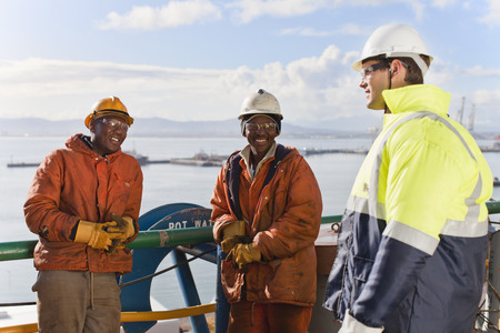 safe water: Workers talking on oil rig