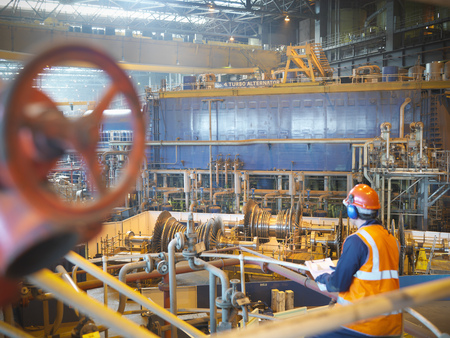 Worker with turbines in power station