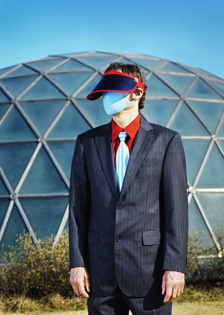 Businessman wearing visor and mask LANG_EVOIMAGES