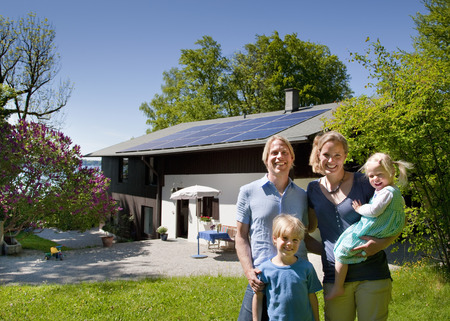 poppa: Family at home with solar panel LANG_EVOIMAGES