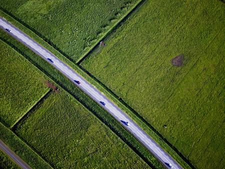 journeying: Paved road through rural landscape