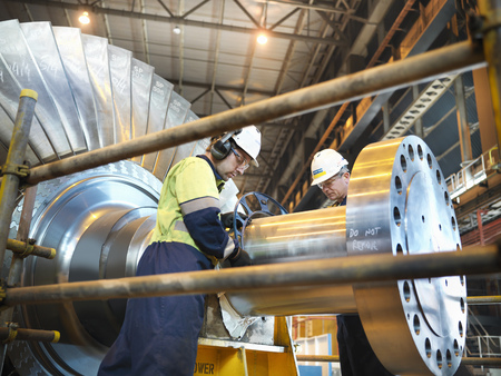 immense: Workers inspect turbine in power station LANG_EVOIMAGES