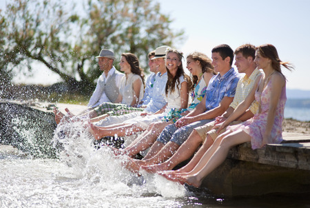 saturating: Friends kicking water from deck