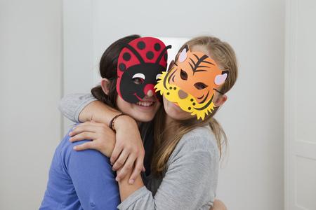 dressups: Smiling girls wearing colorful masks