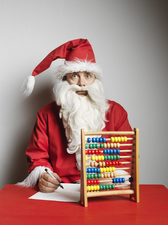 dressups: Man in Santa Claus suit using abacus